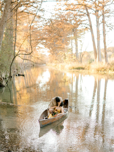 fall engagement couple in canoe