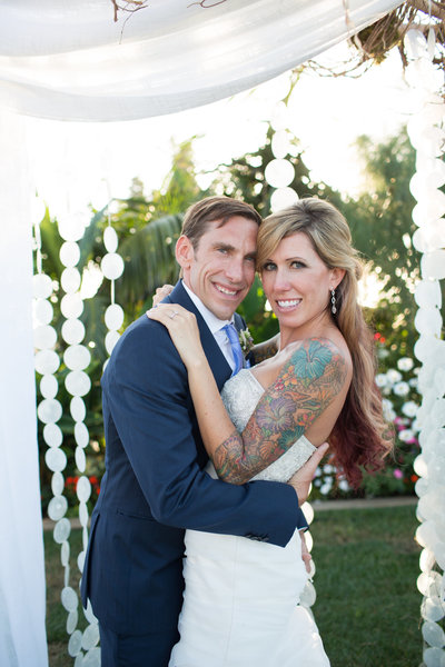 Couple portraits at wedding ceremony site at Cape Rey Carlsbad Wedding Venue