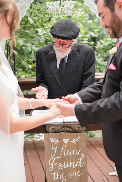 wedding officiant during a ceremony at the Golden Horseshoe Inn