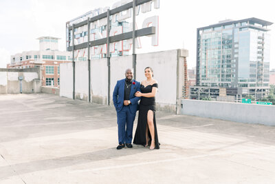 Bride and groom smiling at the camera during thier River Market Parking Deck session in downtown Little Rock
