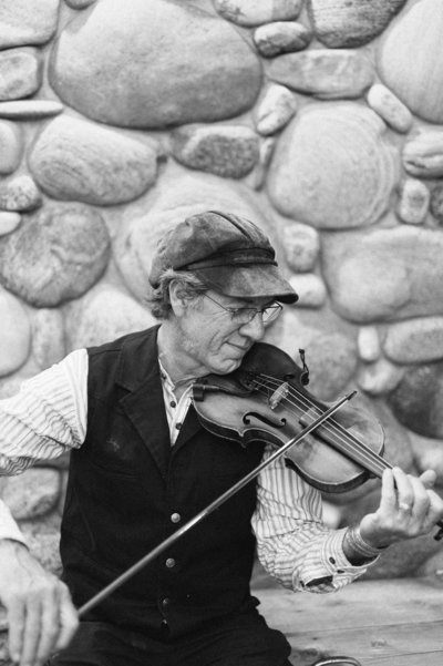 Fiddle Player at Rainbow Ranch Wedding in Big Sky Montana