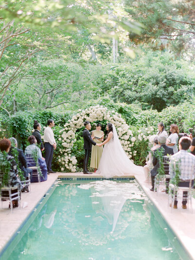 Bride and Groom get married on a reflecting pool in Atlanta