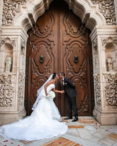 couple kiss mission inn hotel wedding photographer riverside