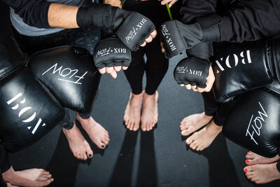 women with kickboxing gloves