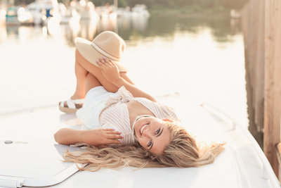 Nautical inspired senior pictures on a boat