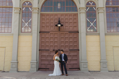 Bride and groom in front of the Aberdeen Pavilion building at Lansdowne Park