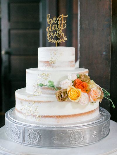 Wedding cake with flowers on one tier