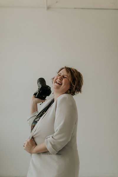 Candid photo of Seattle wedding photographer, Marnie Cornell, laughing