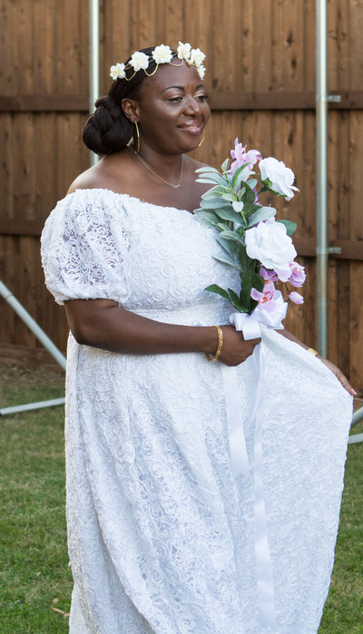 African Bride in White Dress Holding Pink and White Flowers