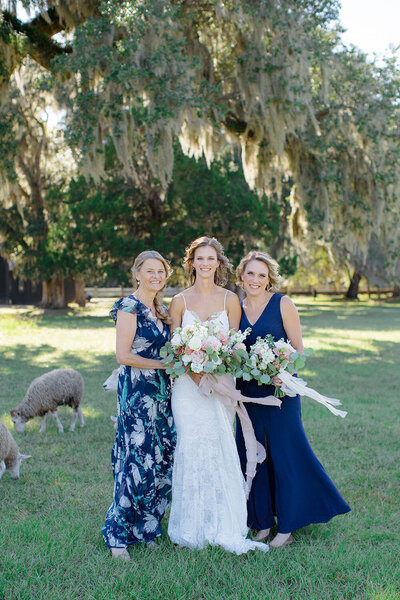 Floral indigo Mother of the Bride dress, spaghetti strap lace wedding dress and solid indigo Maid of Honor dress