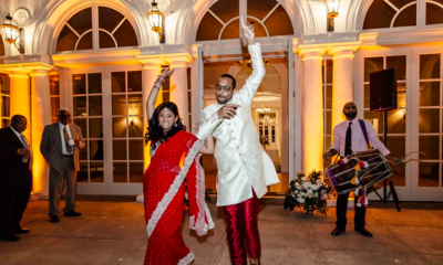 Indian Wedding Couple Celebrating as exiting Boston Mansion