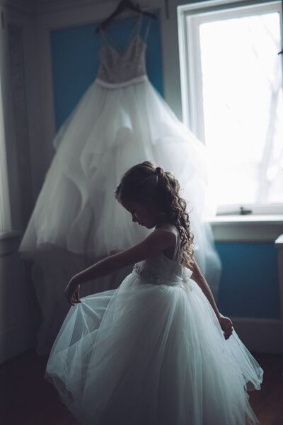 Flower_girl_dancing_and_twirling_by_brides_wedding_dress_Chicago_wedding_photographer_Lauren_Ashley_Studios