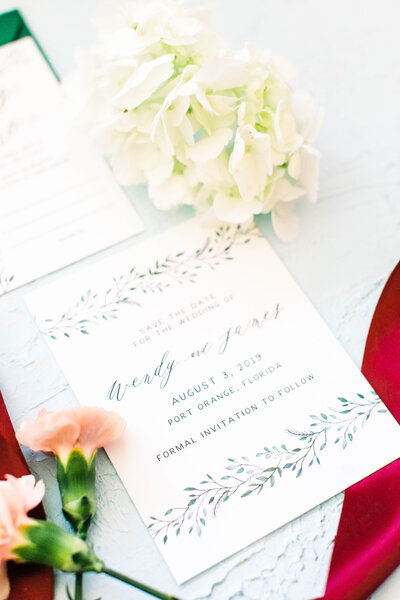 hand painted save the dates with watercolor leaves and greenery