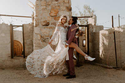 Joshua Tree National Park glam boho wedding in California by Skyler and Vhan at the Ruin venue
