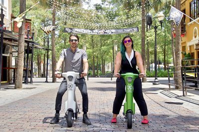 Friends taking E-Bike tour around Central Florida on there Green & White Go-Bike M1