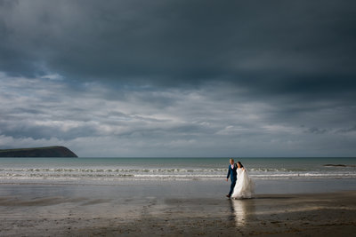 newport pembrokeshire beach wedding with rainy day dramatic sky