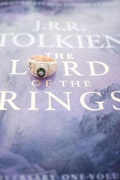 USF gold class ring on top of Lord of the Rings book cover