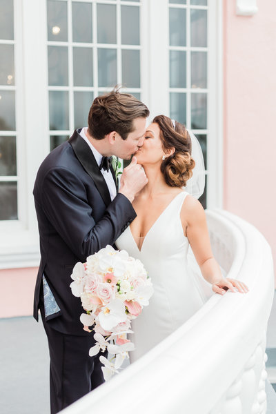 couple kissing at Don Cesar wedding by Costola photography
