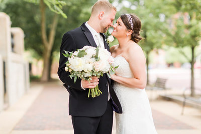 Bride and Groom nose to nose smiling photographed at the Onesto in downtown Canton by a akron ohio wedding photographer