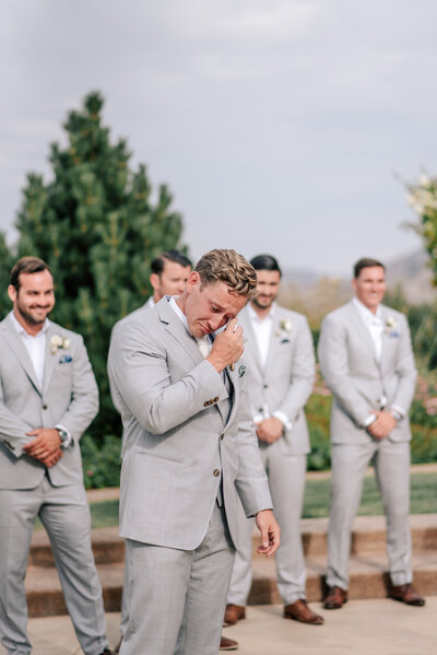 Groom crying as he sees bride walk down the aisle during wedding ceremony at Karma Vineyards