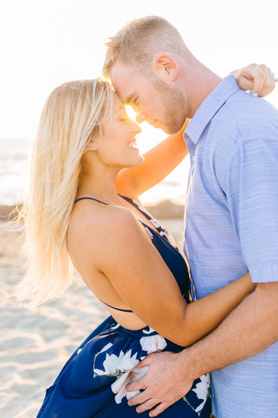 romantic engagement photos on the beach at sunset
