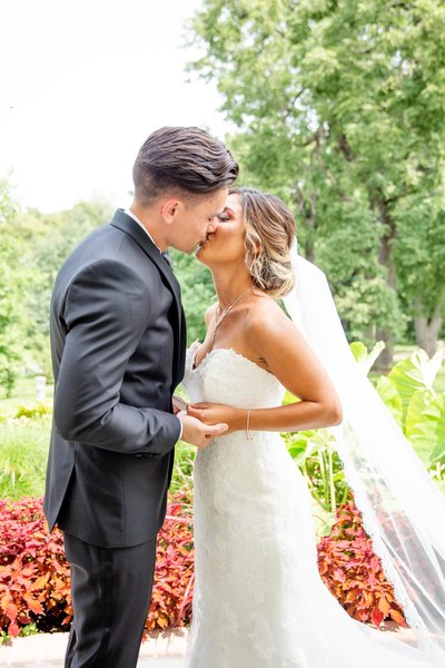 Couple shares a kiss after their first look