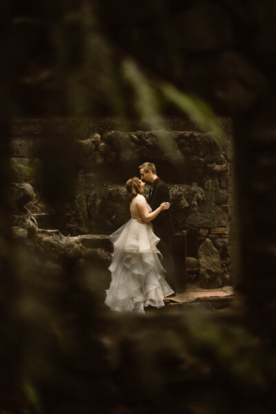 Eloping couple married in a moss covered stone cottage in the Washington wilderness.