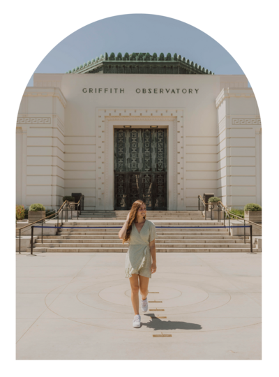 woman walking outside of the Griffith Observatory