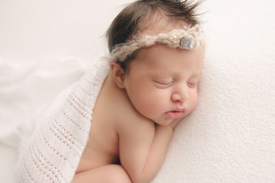 sweet-baby-girl-sleeping-posed-newborn-photography
