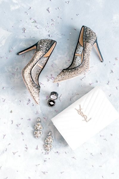 Bridal wedding details flatlay image with Bella Belle shoes and YSL clutch