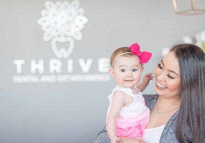 Baby and mom ready for kids friendly dentist in Frisco Texas | Thrive Dental