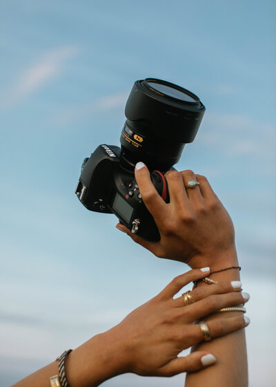 woman's hands holding camera