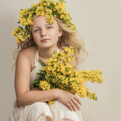 Young blonde teenager wearing flower crown