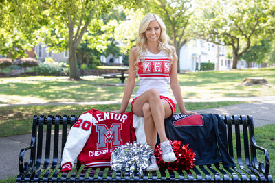 Sports senior pictures of a high school senior cheerleader in a park by Northeast Ohio Photographer, Sharon Holy