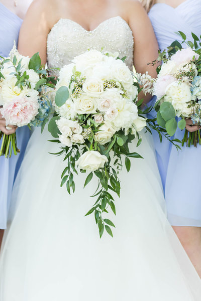 White textured wedding bouquet with greenery crafted by Bouquet Studio and photographed by Loren Jackson Photography at Gervasi Vineyard in Canton Ohio