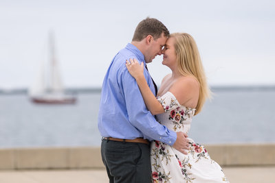 bride and groom standing with sailboat on lake michigan luxury