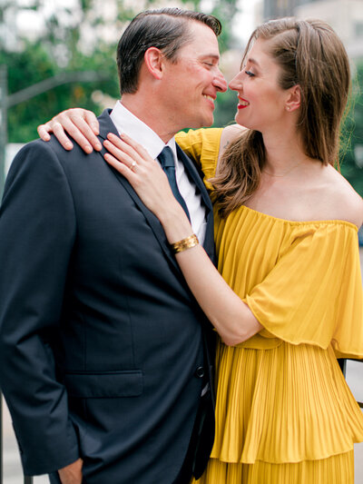 man and woman smiling in yellow dress