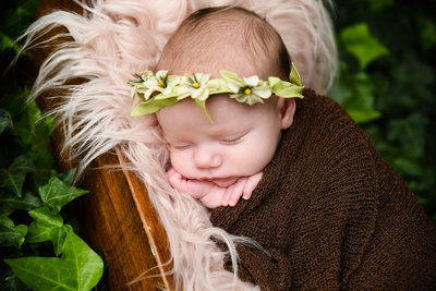Newborn baby with floral crown, Mississippi Newborn Photographer