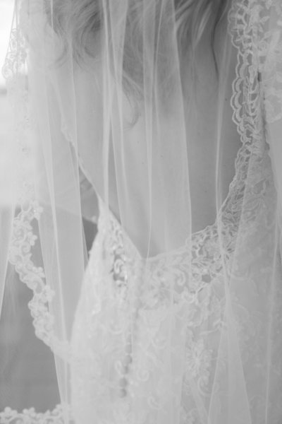 Brianna&AdamWedding435 black and white detail photo of back of dress and veil beautiful bride wedding photographer wisconsin