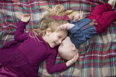 sioux falls family photography, south dakota brother and sister laying on a blanket at sioux rec state park