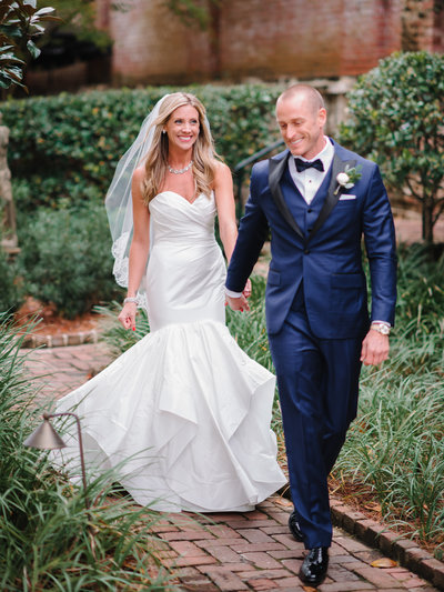 Bride in Watters Wedding Dress with Groom in Navy Blue Tuxedo at William Aiken House Wedding