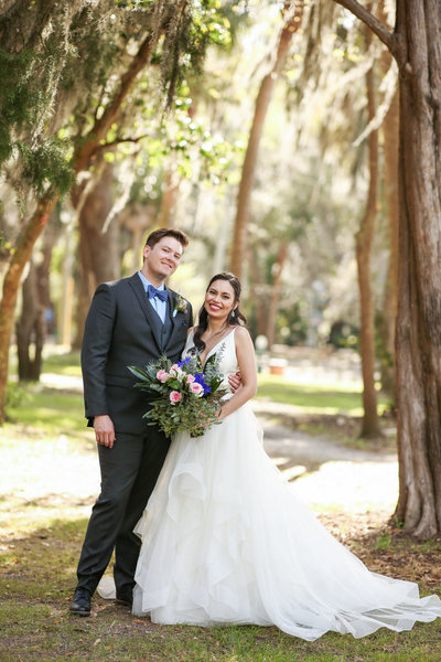 bride and groom in bluffton south carolina after their wedding at oyster factory park