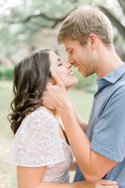 A gorgeous couple kissing during their Savannah, Georgia engagement photos