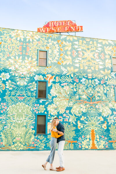 Engaged couple kissing near Palihotel in Culver City, California. Photo taken by Cheers Babe Photo.