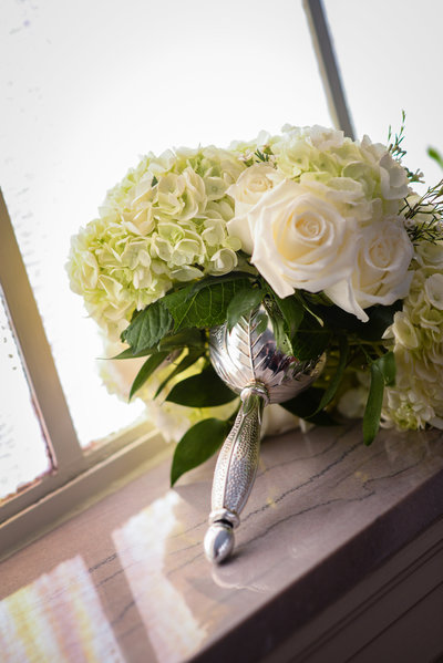 white bridal bouquet with silver tussy mussy holder at a Mississippi Delta Wedding