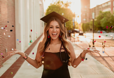 woman wearing graduation cap smiling