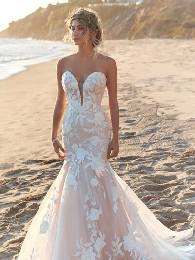 Lace strapless bridal gown with plunging neckline