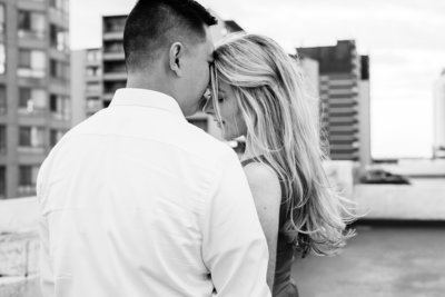 Mairead snuggles into her future husband as he rests his nose on her forehead during their engagement session in Windsor Ontario