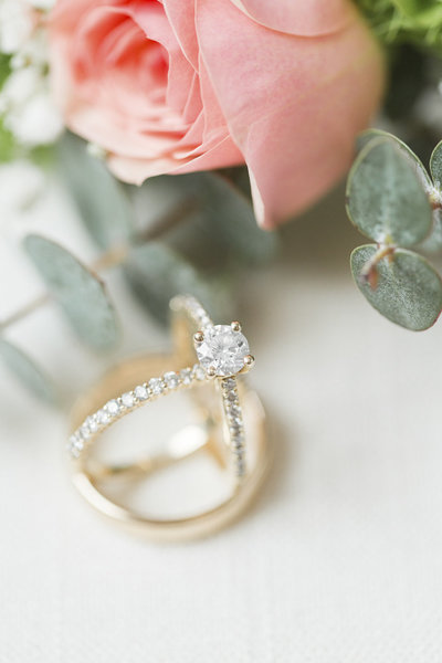 Pink flowers and wedding rings