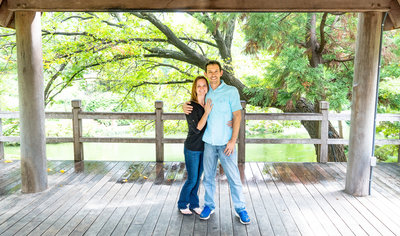 Husband & wife with arms around each other at the Japanese Gardens Ft. Worth